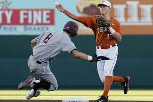 Bret Boswell take relay throw for a double play in a game of the Texas A&M University versus the University of Texas at UFCU Disch-Falk Field in Austin, Texas on March 14, 2017