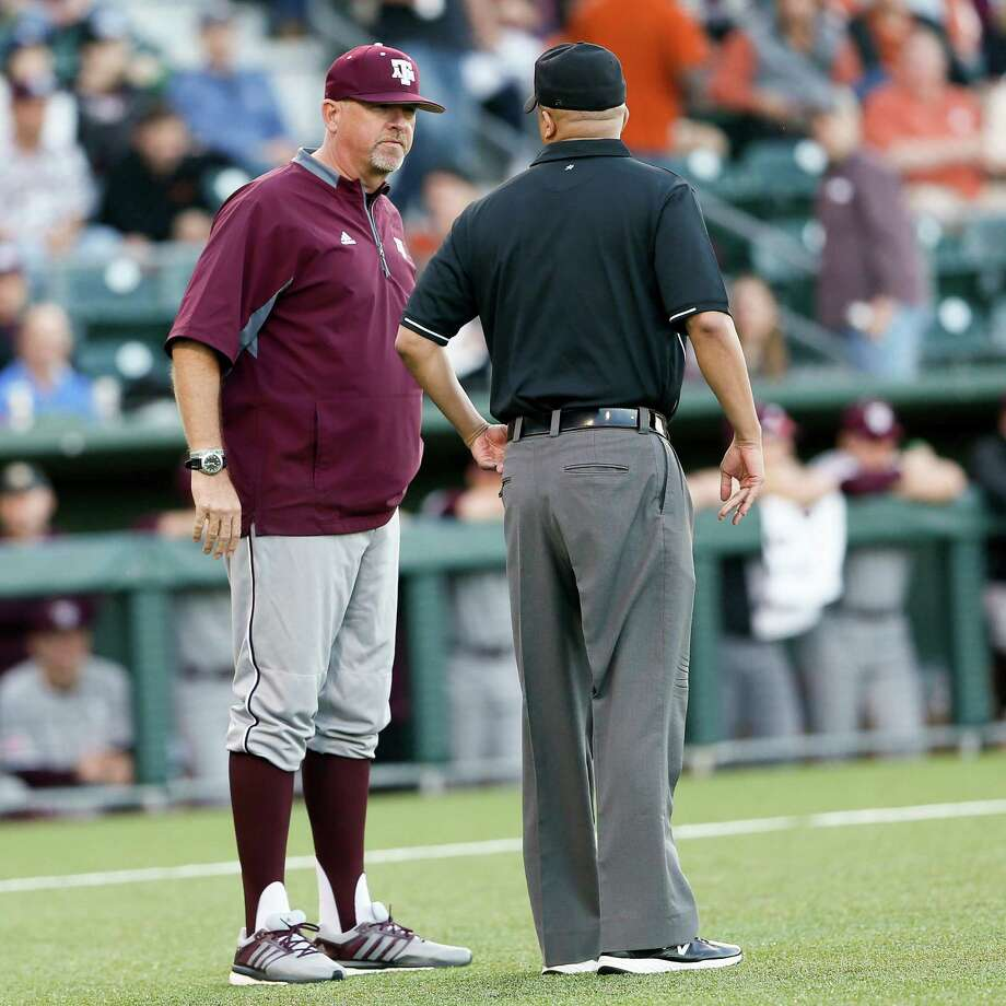 Head coach Rob Childress discusses a call with umpire in a game of the Texas A&M University versus the University of Texas at UFCU Disch-Falk Field in Austin, Texas on March 14, 2017 Photo: Andy Nietupski, Andy Nietupski For AMERICAN STATESMAN / Andy Nietupski