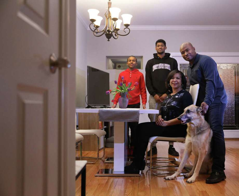 A Veterans Affairs loan helped James and Lori Pickett, with their children Cameron, 13, Jaquan, 22, and dog Destiny, purchase a home in Chicago. Photo: Chris Sweda, Chicago Tribune Photo By / Chicago Tribune
