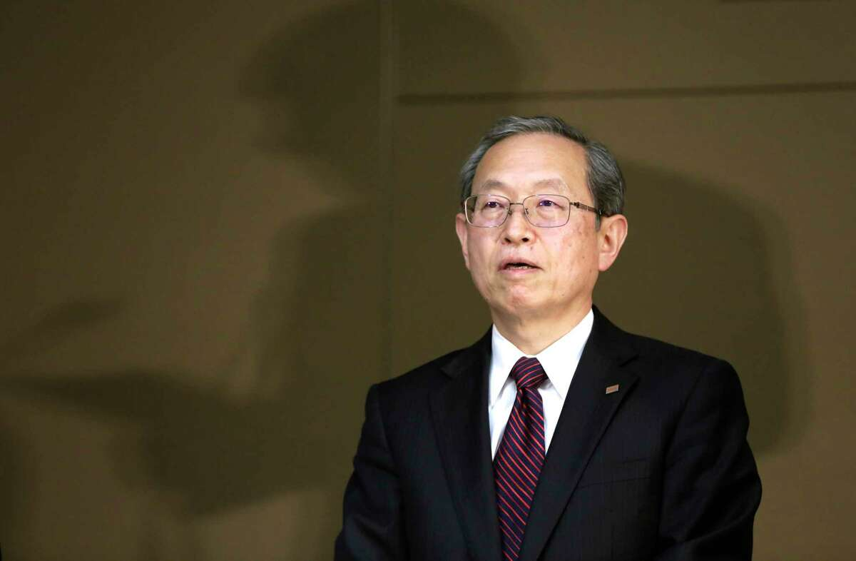 Toshiba Corp. President Satoshi Tsunakawa listens to the reports during a press conference at the company's headquarters in Tokyo, Tuesday, March 14, 2017. Troubled Japanese nuclear and electronics company Toshiba said Tuesday it was considering selling its money-losing Westinghouse operations in the U.S. (AP Photo/Eugene Hoshiko)
