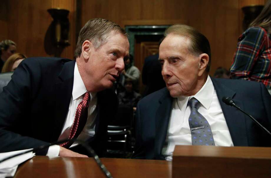 """United States Trade Representative-nominee Robert Lighthizer, left, talks to former Sen Bob Dole, R-Kan., during his confirmation hearing on Capitol Hill in Washington, Tuesday, March 14, 2017. President Donald Trump's pick to represent the country in trade negotiations says the U.S. should have an """"America first trade policy."""" (AP Photo/Manuel Balce Ceneta) Photo: Manuel Balce Ceneta, STF / Copyright 2017 The Associated Press. All rights reserved."""