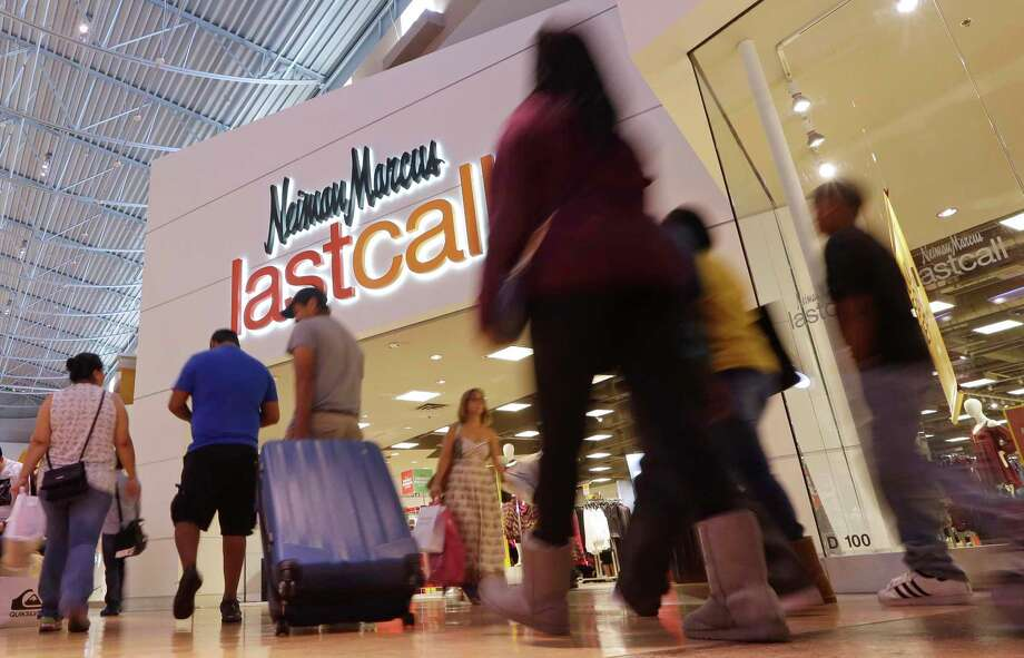 FILE - In this Friday, Nov. 25, 2016, file photo, shoppers walk by a Neiman Marcus department store in Miami. Neiman Marcus says it's exploring strategic alternatives including a sale of the company. The announcement came as the retailer, which also operates Bergdorf Goodman, reported a loss in its second fiscal quarter that ended Jan. 28, 2017, and its sixth consecutive quarterly drop for a key revenue measure. (AP Photo/Alan Diaz, File) Photo: Alan Diaz, STF / ap