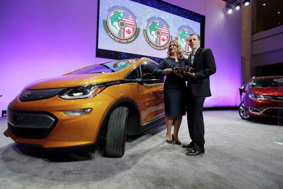 General Motors Executive Chief Engineer Autonomous & Electrified Vehicles and New Technology Pam Fletcher, left, and Bolt Chief Engineer Josh Tavel stand next to a Chevy Bolt after being named top car in the North America at the North American International Auto show, Monday, Jan. 9, 2017, in Detroit. (AP Photo/Carlos Osorio) Photo: Carlos Osorio, STF / Copyright 2017 The Associated Press. All rights reserved.
