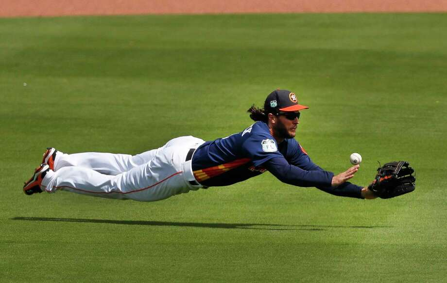 Astros center fielder Jake Marisnick makes a valiant effort but can't come up with a ball hit by the Mets' Curtis Granderson that went for a double in the fifth inning Tuesday. Photo: John Bazemore, STF / Copyright 2017 The Associated Press. All rights reserved.