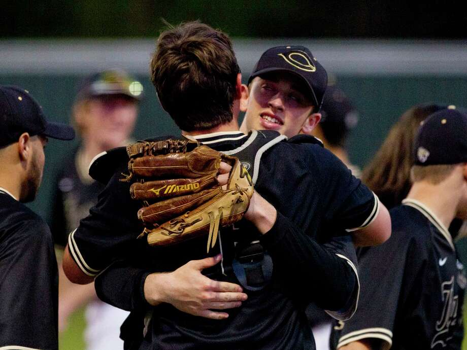 Conroe starting pitcher Marshall Prether celebrates with catcher Scott Horn after giving up just one hit in the Tigers' 2-0 win over Oak Ridge during a District 12-6A high school baseball game at Elmore Field on Tuesday, March 14, 2017, in Conroe. Photo: Jason Fochtman, Staff Photographer / © 2017 Houston Chronicle