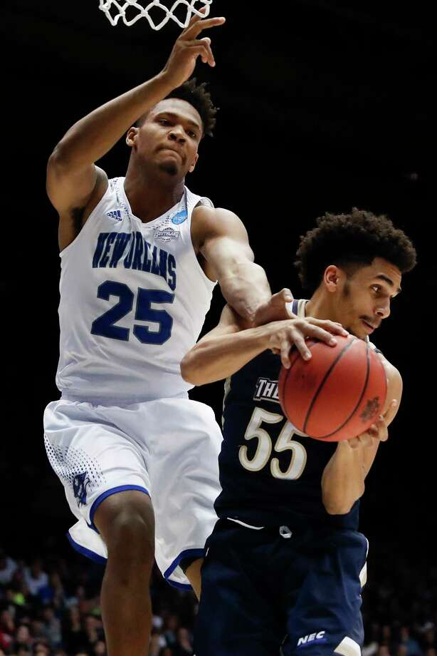 Mount St. Mary's Elijah Long (55) and New Orleans' Travin Thibodeaux (25) battle for a rebound in the second half of a First Four game of the NCAA college basketball tournament, Tuesday, March 14, 2017, in Dayton, Ohio. Mount St. Mary's won 67-66. (AP Photo/John Minchillo) Photo: John Minchillo, STF / AP