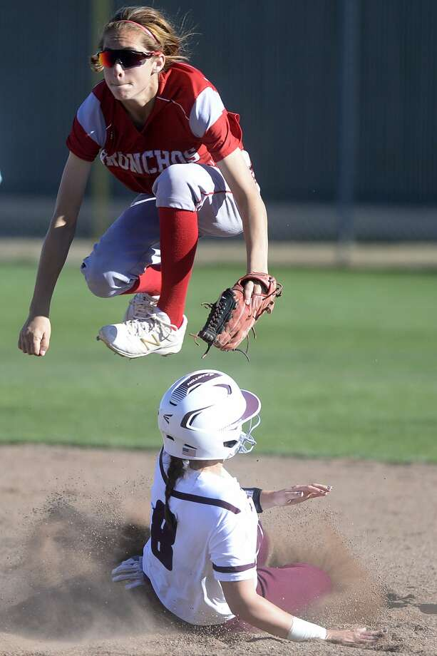 Odessa High shortstop Skylar Herrera jumps over Lee's Kirklynd Newsom (8) to make a double play on March 14, 2017, at Gene Smith Field.  James Durbin/Reporter-Telegram Photo: James Durbin