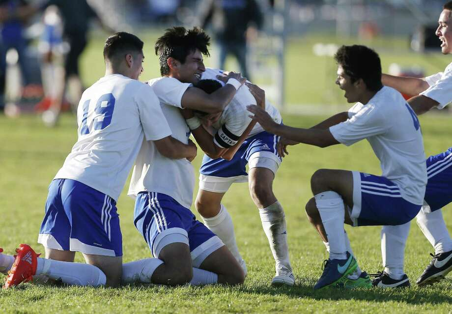 Jay's Jonathan Driggers (second from left) gets rushed by teammates after scoring the eventual winning goal against Brandeis in boys soccer at Northside Soccer Fields on Tuesday, Mar. 14, 2017. Jay rallied in the second half to defeat Brandeis, 2-1, and earned a spot in the playoffs. (Kin Man Hui/San Antonio Express-News) Photo: Kin Man Hui, Staff / San Antonio Express-News / ©2017 San Antonio Express-News