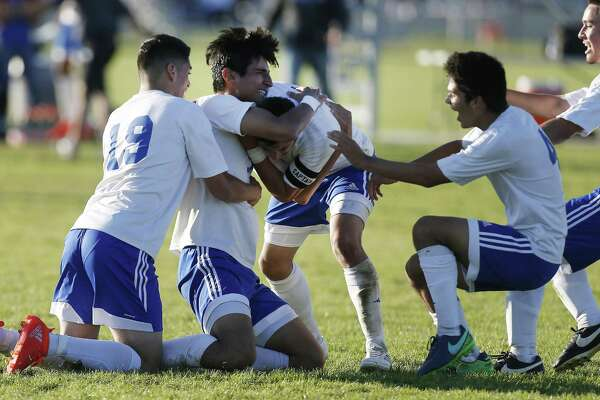 Jay's Jonathan Driggers (second from left) gets rushed by teammates after scoring the eventual winning goal against Brandeis in boys soccer at Northside Soccer Fields on Tuesday, Mar. 14, 2017. Jay rallied in the second half to defeat Brandeis, 2-1, and earned a spot in the playoffs. (Kin Man Hui/San Antonio Express-News)