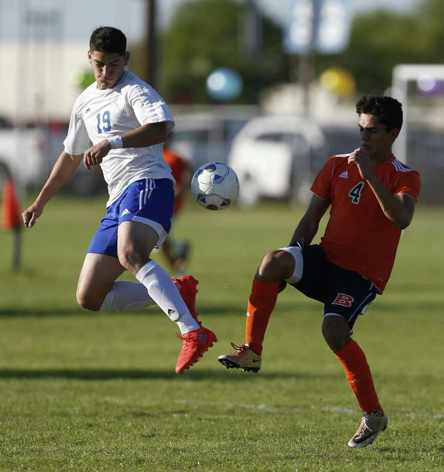 Jay's Diego Jasso (19) and Brandeis'  Julian Vargas (04) battle for control of the ball in boys soccer at Northside Soccer Fields on Tuesday, Mar. 14, 2017. Jay rallied in the second half to defeat Brandeis, 2-1, and earned a playoff berth. (Kin Man Hui/San Antonio Express-News) Photo: Kin Man Hui, Staff / San Antonio Express-News / ©2017 San Antonio Express-News