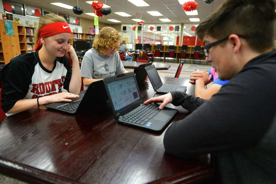 From left, Miley Overstreet, Reagan Mathews and Christopher Swift demonstrate use of Kountze High School's new laptops. The school obtained the $300,000 worth of laptops through state and federal grants.  Noah Cafter also sits at the table.    Photo taken Tuesday, March 07, 2017 Guiseppe Barranco/The Enterprise Photo: Guiseppe Barranco, Photo Editor