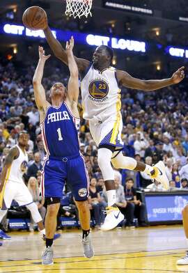Golden State Warriors' Draymond Green blocks a shot by Philadelphia 76ers' T.J. McConnell in 4th quarter of Warriors' 106-104 win during NBA game at Oracle Arena in Oakland, Calif., on Tuesday, March 14, 2017.