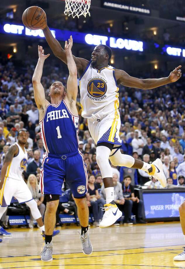 Golden State Warriors' Draymond Green blocks a shot by Philadelphia 76ers' T.J. McConnell in 4th quarter of Warriors' 106-104 win during NBA game at Oracle Arena in Oakland, Calif., on Tuesday, March 14, 2017. Photo: Scott Strazzante, The Chronicle