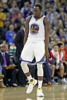 Golden State Warriors' Draymond Green celebrates his 3-pointer in 4th quarter of 106-104 win over Philadelphia 76ers during NBA game at Oracle Arena in Oakland, Calif., on Tuesday, March 14, 2017.
