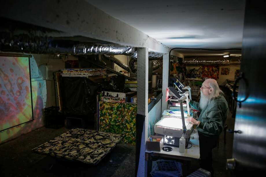 Artist Bill Ham demonstrates his light projection paintings at his studio in San Francisco. Photo: Gabrielle Lurie, The Chronicle