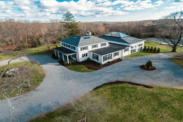 The Governors Estate,Ó at 345 Governors Lane includes the main house, newly renovated guest cottage, and its 3.8-acre property also has a championship tennis court.