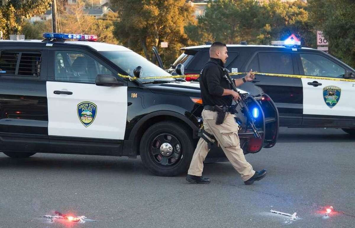 Fremont police shot and killed a female passenger riding in a packed vehicle that rammed a detective's car during a traffic stop in Hayward on Tuesday near an East Bay university, officials said.