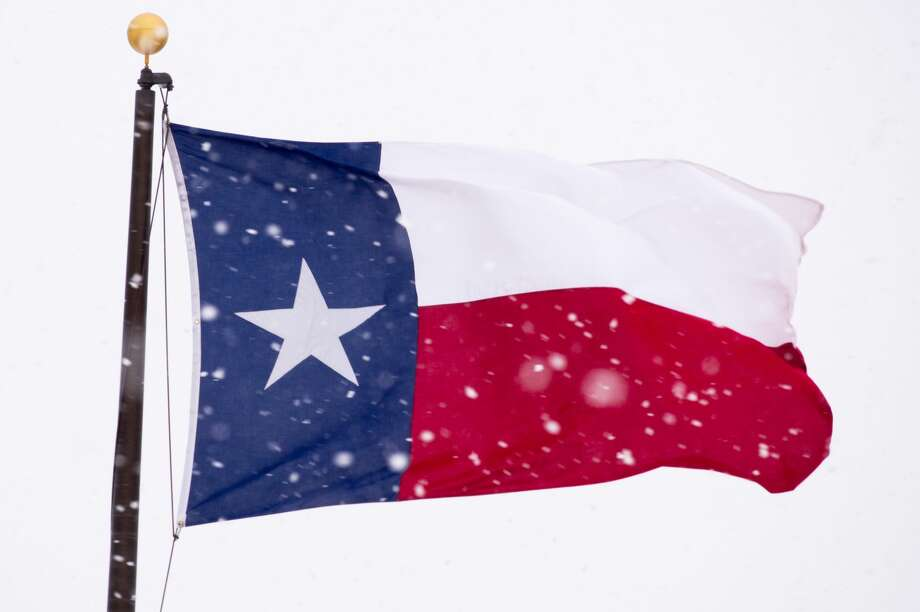 The Texas state flag is battered by high wind and heavy snow on December 27, 2015 in Lubbock, Texas.