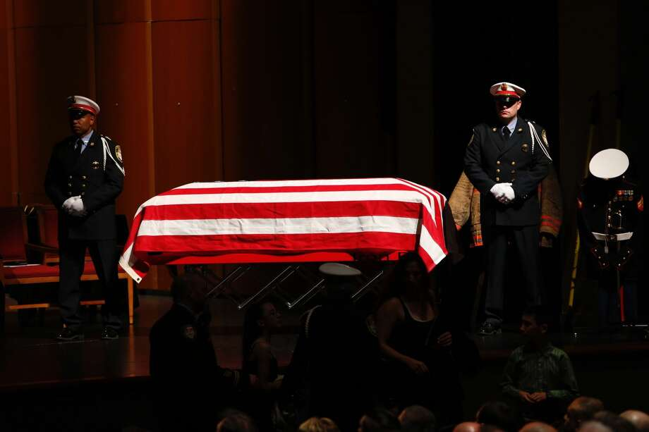 "An honor guard stands at attention by the casket of Houston Fire Capt. William ""Iron Bill"" Dowling during the memorial for the fallen firefighter at Houston Baptist University on Wednesday, March 15, 2017, in Houston. ( Brett Coomer / Houston Chronicle) Photo: Brett Coomer/Brett Coomer / Houston Chronicle"