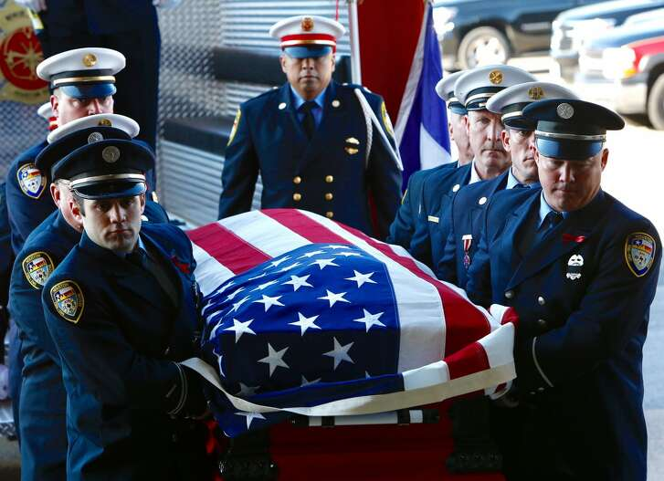 """Houston Fire Capt. William """"Iron Bill"""" Dowling's casket is carried off the Honor Guard engine for the memorial for the fallen firefighter at Houston Baptist University on Wednesday, March 15, 2017, in Houston. ( Brett Coomer / Houston Chronicle)"""