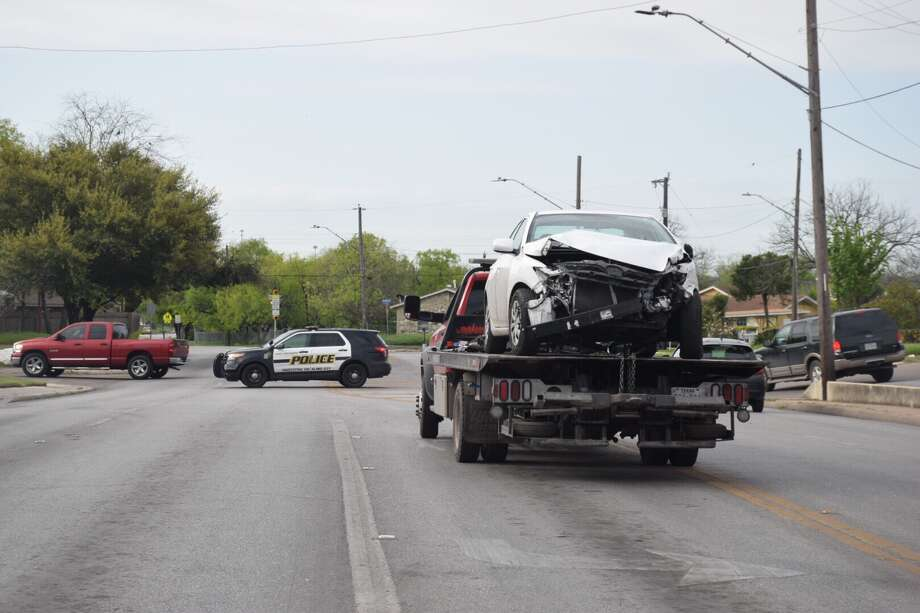 A woman was hospitalized Wednesday, March 15, 2017, after her vehicle was struck by a pickup truck that ran a red light at a West Side intersection. Photo: Caleb Downs / San Antonio Express-News