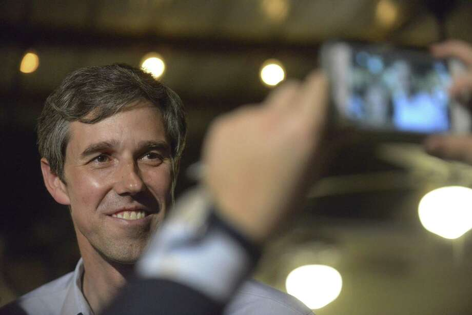 U.S. Rep. Beto O'Rourke (D-El Paso) meets with people at Tycoon Flats in San Antonio on Saturday, March 11, 2017. O'Rourke is a Democrat who might run against Republican Ted Cruz in the next senate race. Photo: Billy Calzada, Staff / San Antonio Express-News / San Antonio Express-News