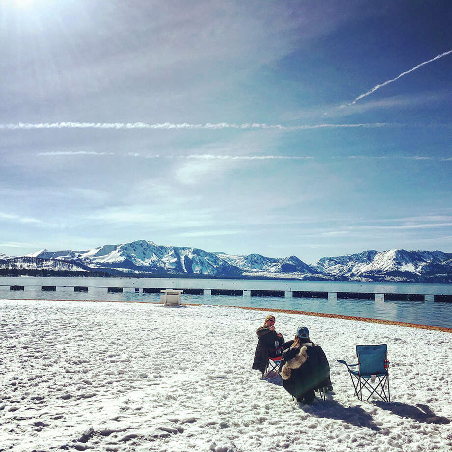 Guidebook writer Jannine Sprout drinks hot chocolate along the snowy shores of Lake Tahoe on March 14, 2017. Photo: Janine Sprout