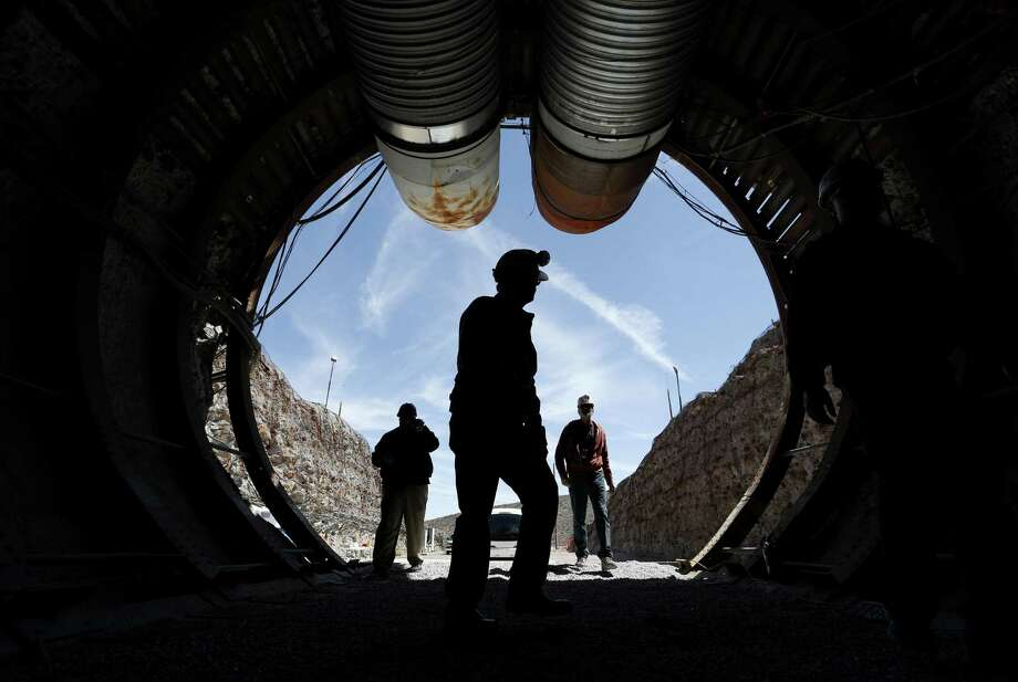 People walk into the south portal of Yucca Mountain during a congressional tour Thursday, April 9, 2015, near Mercury, Nevada. Several members of Congress toured the proposed radioactive waste dump 90 miles northwest of Las Vegas. Photo: John Locher /Associated Press / AP