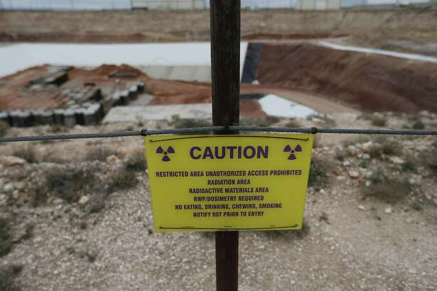 A caution sign stands outside the low-level radioactive waste site owned by Waste Control Specialists near Andrews, Texas.