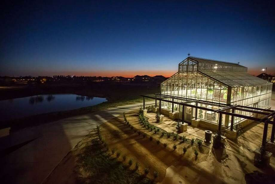 Cane Island's glass-walled conservatory, the only such facility in the area, is available for seasonal use in the fall and spring.  The enclosed, air-conditioned space with its wall of fresh flowers is ideal for showers or smaller social events. Photo: Cane Island