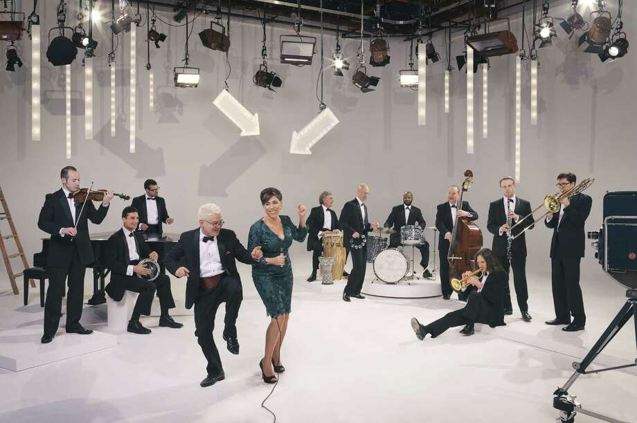 """Pink Martini, the """"little orchestra,"""" returns to the Houston Symphony March 17-19. China Forbes, vocalist, dances with Thomas Lauderdale, who founded Pink Martini in 1994. Photo: Chris Hornbecker"""