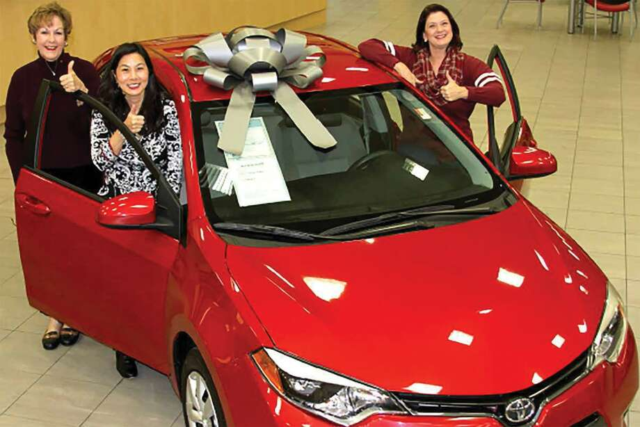 The Fort Bend Aggie Moms' Club is raising scholarship funds through a raffle. The grand prize is a 2017 Toyota Corolla. From left are Fort Bend Aggie Moms Sally Berlocher, Terri Wang and Carol Gaas. Car color may change at the time of availability. Photo: Fort Bend Aggie Moms