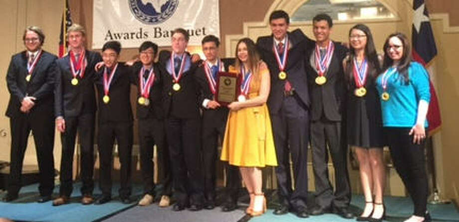 The Dulles Academic Decathlon team captured Dulles'first state championship since 1987. From left are: Coach Andrew Hartman Jared Roth, William Huynh, Ethan Tu, James Kesler, Sam Steinman-Friedman, Madison Gabino, Alex Huffman, Leighton Nylander,  Kaidy Li and coach Kelsey Halfen. Photo: Dulles High