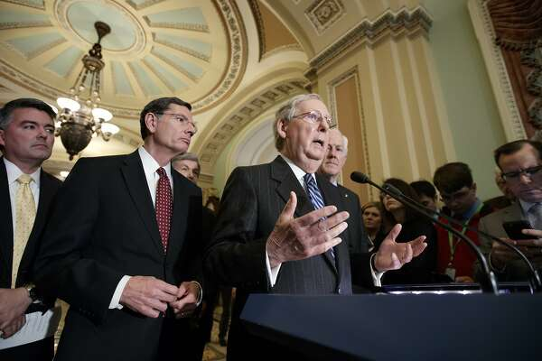 Senate Majority Leader Mitch McConnell, R-Ky., joined by, from left, Sen. Cory Gardner, R-Colo., Sen. John Barrasso, R-Wyo., Sen. Roy Blunt, R-Mo., and Majority Whip John Cornyn, R-Texas, speaks with reporters at the Capitol in Washington, Tuesday, March, 14, 2017. The White House and Republican leaders in Congress are scrambling to shore up support for their health care bill after findings from the Congressional Budget Office estimated that 14 million people would lose insurance coverage in the first year alone under the GOP replacement for Obamacare. (AP Photo/J. Scott Applewhite)