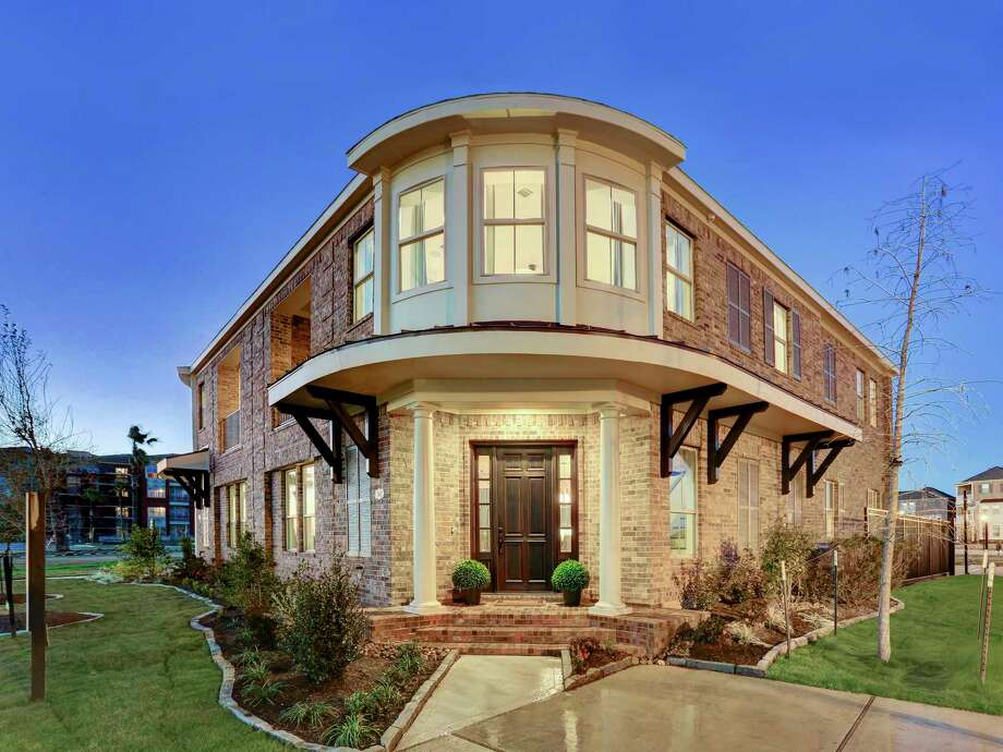 Gracepoint Homes is celebrating the grand opening of a two-story brownstone model at The Point at Imperial which is situated within the Imperial development in old Sugar Land Photo: Gracepoint Homes