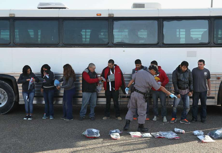 Immigrants collect their belongings before being deported across an international bridge into Mexico on March 14, 2017 from Hidalgo, Texas. The Trump administration has ordered an increase in deportations, part of the larger strategy to get tough on illegal immigration and strengthen border security. The U.S. Border Patrol has reported that illegal crossings from Mexico have dropped some 40 percent along the southwest border since Trump took office.  Photo: John Moore, Getty Images