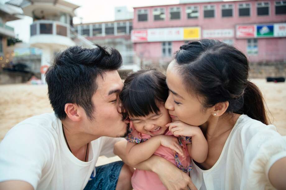 "Parenting success is measured in ""the way your kids describe you"" according to one poem. Photo: Tang Ming Tung / Getty Images"