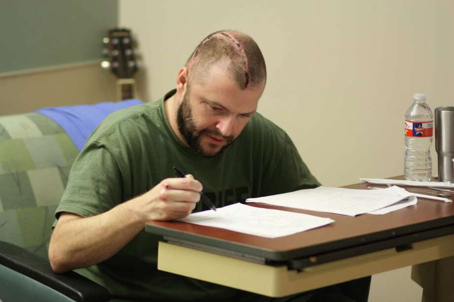 Liberty County Pct. 1 Constable Justin Johnston works through a sheet of problems to improve his cognitive abilities. Johnston is recovering in theTIRR Memorial Hermann Hospital in Houston from injuries he received Feb. 15 when he was hit by a vehicle while directing traffic. Photo: Vanesa Brashier