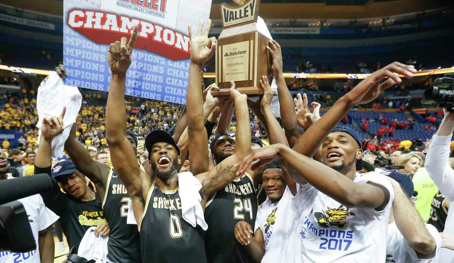 Wichita State players react after winning the Missouri Valley Conference Tournament with a 71-51 win over Illinois State on Sunday, March 5, 2017 in St. Louis, Mo. Photo: Travis Heying, TNS / Wichita Eagle