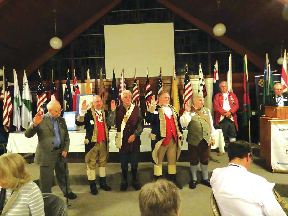 Newly elected chapter officers take the oath of office. Shown are (L-R) Lloyd Schwarz, chaplain; Jim DeGroff, registrar; Tom Beavers, treasurer; Robert Ridenour, vice president, Charles Dobias, president. Marvin Meng, outgoing chapter president looks on as State President Toby Chamberlain administers the oath. Not shown is the chapter secretary. Photo: For The Intelligencer