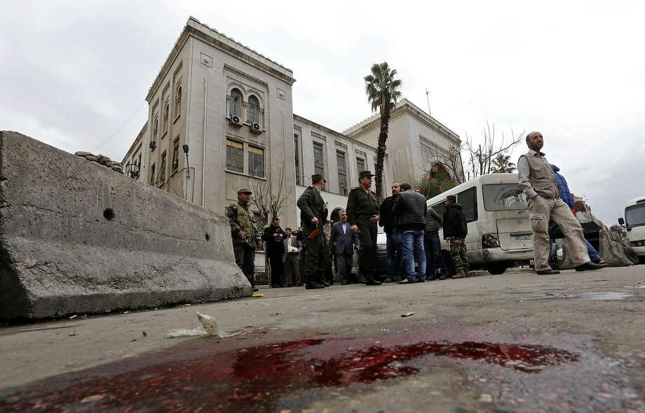Security forces cordon off the area after a bomb attack at the main judicial building in Damascus, Syria, which killed at least 30 people. Photo: LOUAI BESHARA, AFP/Getty Images
