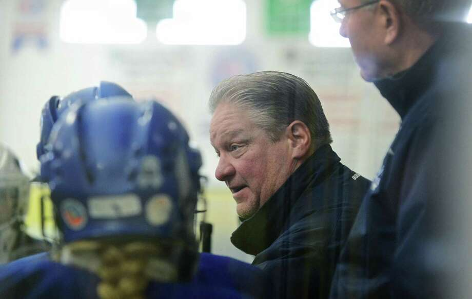 Darien haed coach Jamie Tropsa instructs his players as they take on Stamford-Westhill-Staples co-op team during their FCIAC girls ice hockey game Saturday, January 21, 2017, at Terry Connor Rink in Stamford, Conn. Photo: Erik Trautmann / Hearst Connecticut Media / Norwalk Hour
