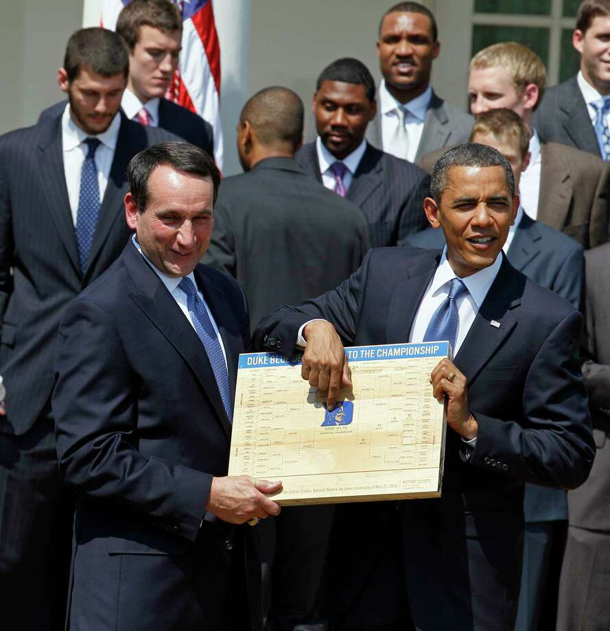 "FILE - In this May 27, 2010 file photo, President Barack Obama looks over the bracket with Duke University basketball Coach Mike Krzyzewski in the Rose Garden of the White House in Washington, where he honored the team. From his campaign fist bump to his theatrical mic drop at the last White House correspondents' dinner, Barack Obama ruled as America's pop culture president. His two terms played out like a running chronicle of the trends of our times: slow-jamming the news with Jimmy Fallon, reading mean tweets with Jimmy Kimmel, filling out his NCAA basketball bracket on ESPN, cruising with Jerry Seinfeld on ""Comedians in Cars Getting Coffee."" (AP Photo/Alex Brandon, File) Photo: Alex Brandon, Associated Press / AP2010"