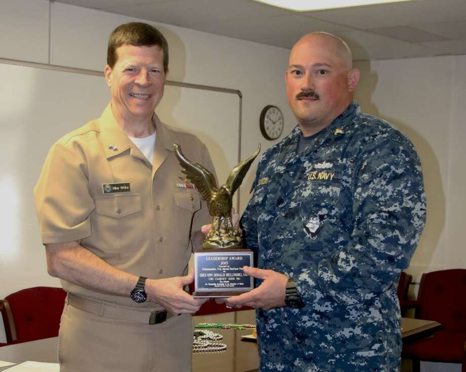 Rear Adm. Mike White, Commander, Naval Education and Training Command (NETC), presents the Navy and Marine Corps Association (NMA) Leadership Award to Senior Chief Gas Turbine Systems Technician Donald Bellnoski , received while assigned to USS Carney (DDG 64). Recipients of the NMA Leadership Award are selected by their peers for exhibiting the highest levels of excellence in leadership.