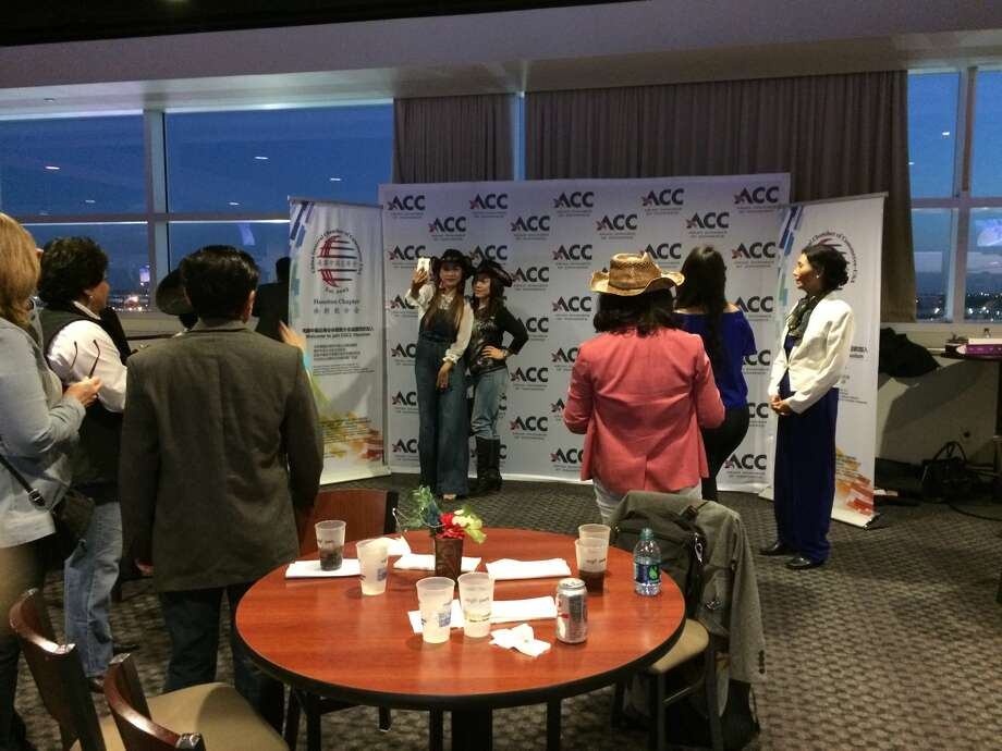 Asian Night at the Rodeo included an Asian Chamber of Commerce backdrop for selfies.