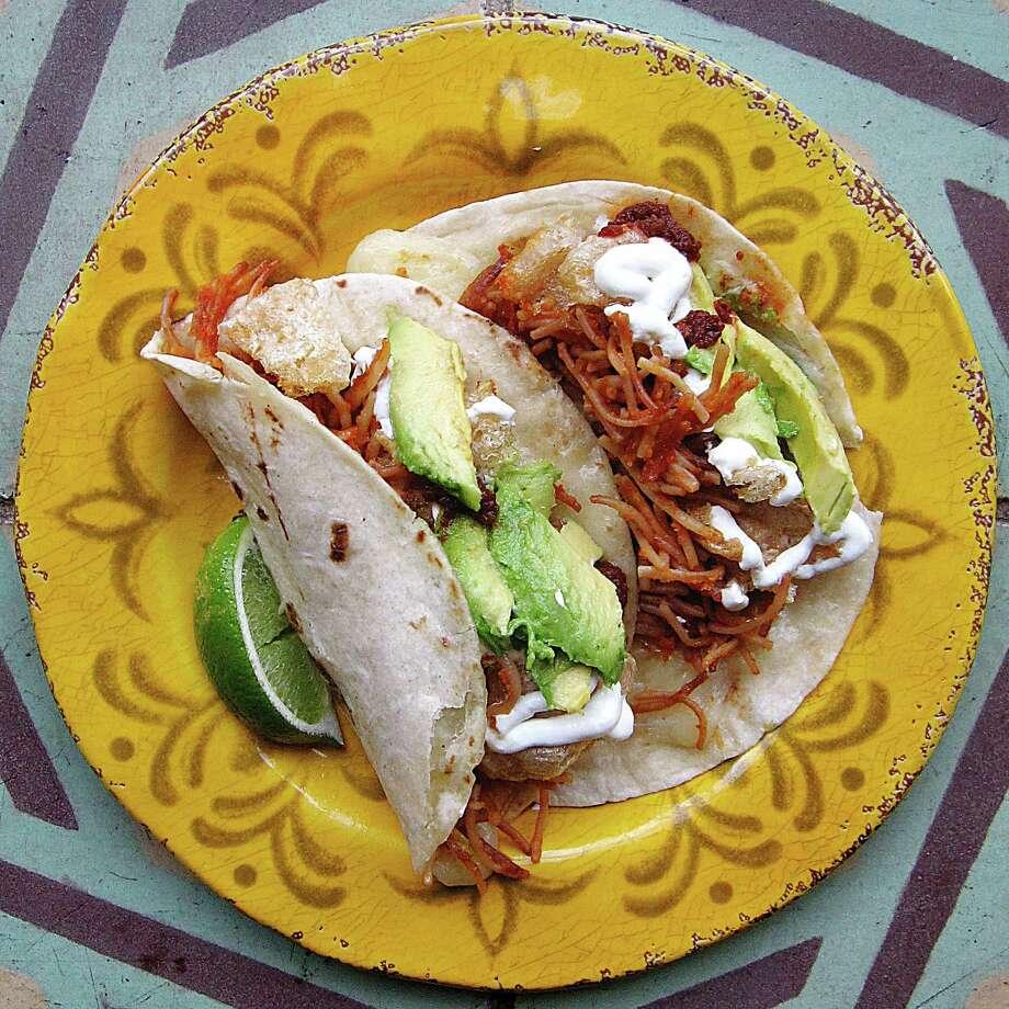 Tacos de fideo with soup noodles, chicharrones, crema and avocado from La Cantinita on Blanco Road. Photo: Mike Sutter /San Antonio Express-News