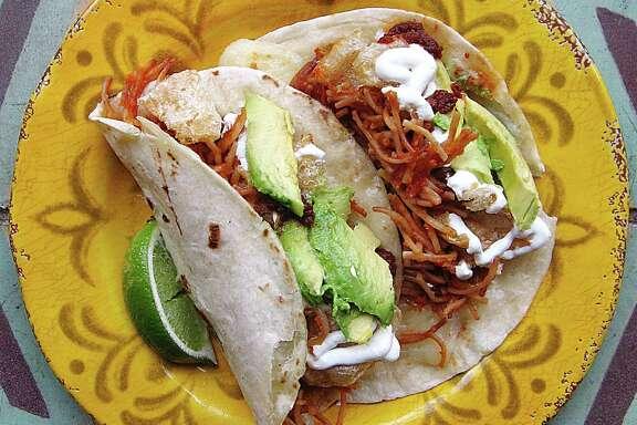 Tacos de fideo with soup noodles, chicharrones, crema and avocado from La Cantinita on Blanco Road.
