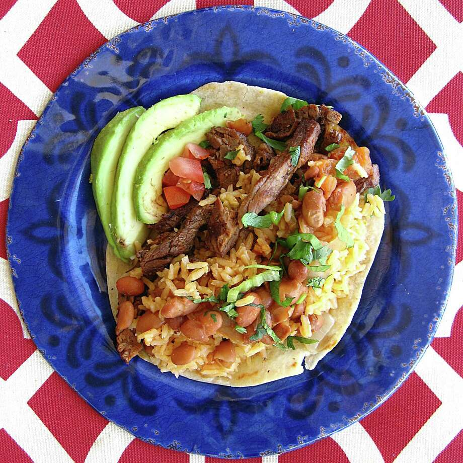 Beef fajita taco on a handmade flour tortilla from Tito's Mexican Restaurant on South Alamo Street. Photo: Mike Sutter /San Antonio Express-News