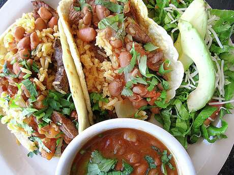 The Mi Favorito Taco Plate at Tito's Mexican Restaurant comes with beef fajitas, rice, charro beans and an avocado salad.