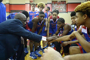 West Brook coach Andre Boutte gives last second instructions during a time-out in overtime against Kelly during the James Gamble Classic boys basketball tournament final game Thursday night at Memorial High School. Photo taken Thursday, December 29, 2016 Kim Brent/The Enterprise